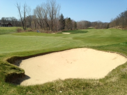 #17 - The green feeds mis-hit approaches into this difficult bunker