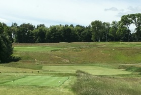 #13 - From the tee down into the landing area, with the green above