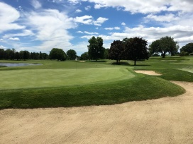 #14 - Wrap-around bunker behind the green